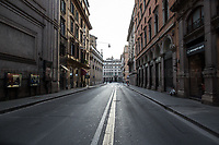 """Via del Tritone.<br /> <br /> Rome, 12/03/2020. Documenting Rome under the Italian Government lockdown for the Outbreak of the Coronavirus (SARS-CoV-2 - COVID-19) in Italy. On the evening of the 11 March 2020, the Italian Prime Minister, Giuseppe Conte, signed the March 11th Decree Law """"Step 4 Consolidation of 1 single Protection Zone for the entire national territory"""" (1.). The further urgent measures were taken """"in order to counter and contain the spread of the COVID-19 virus"""" on the same day when the WHO (World Health Organization, OMS in Italian) declared the coronavirus COVID-19 as a pandemic (2.).<br /> ISTAT (Italian Institute of Statistics) estimates that in Italy there are 50,724 homeless people. In Rome, around 20,000 people in fragile condition have asked for support. Moreover, there are 40,000 people who live in a state of housing emergency in Rome's municipality.<br /> March 11th Decree Law (1.): «[…] Retail commercial activities are suspended, with the exception of the food and basic necessities activities […] Newsagents, tobacconists, pharmacies and parapharmacies remain open. In any case, the interpersonal safety distance of one meter must be guaranteed. The activities of catering services (including bars, pubs, restaurants, ice cream shops, patisseries) are suspended […] Banking, financial and insurance services as well as the agricultural, livestock and agri-food processing sector, including the supply chains that supply goods and services, are guaranteed, […] The President of the Region can arrange the programming of the service provided by local public transport companies […]».<br /> Updates: on the 12.03.20 (6:00PM) in Italy there 14.955 positive cases; 1,439 patients have recovered; 1,266 died.<br /> <br /> Footnotes & Links:<br /> Info about COVID-19 in Italy: http://bit.do/fzRVu (ITA) - http://bit.do/fzRV5 (ENG)<br /> 1. March 11th Decree Law http://bit.do/fzREX (ITA) - http://bit.do/fzRFz (ENG)<br /> 2. http://bit.do/fzRKm"""