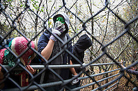 Climate activists break through the first fence as they take direct action against the coal fired power station at Ratcliffe on Soar, south of Nottingham. The power station, owned by E.ON, is the third largest emitter of greenhouse gases in the UK.