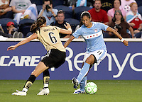 Chicago Red Star forward Cristiane (11) makes a move to get around FC Gold Pride defender Brandi Chastain (6).  Cristiane would go on to score her 3rd goal of the game on the play.  The Chicago Red Stars defeated the FC Gold Pride 3-1 at Toyota Park in Bridgeview, IL on July 12, 2009.