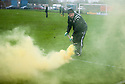 The second of two flares thrown on to the pitch by Berwick fans.