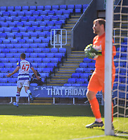 5th April 2021; Madejski Stadium, Reading, Berkshire, England; English Football League Championship Football, Reading versus Derby County;  David Marshall of Derby County is left frustrated as George Puşcaş of Reading celebrates scoring in 54th minute 2-0
