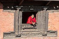 Nepal, Patan.  Woman in Window of Patan Museum.