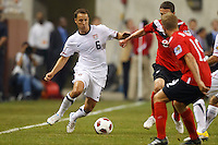 7 June 2011: USA Men's National Team defender Steve Cherundolo (6) dribbles the ball at Canada midfielder Will Johnson (8) during the CONCACAF soccer match between USA MNT and Canada MNT at Ford Field Detroit, Michigan. USA won 2-0.