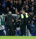 Alan Stubbs shakes hands with Mark Warburton at full-time