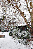 Kingston upon Thames, England. Wooden garden building covered with snow.