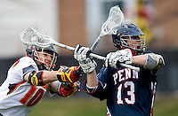 Michael Shakespeare (10) of Maryland tries to stop the shot of John Conneely (13) of Penn at Ludwig Field in College Park, Maryland.