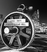 A large gear announces the historic site of the Kahuku Sugar Mill, O'ahu.