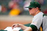 Baylor Bears assistant coach Trevor Mote watches the action from the dugout during the game against the Houston Cougars at Minute Maid Park on March 4, 2011 in Houston, Texas.  Photo by Brian Westerholt / Four Seam Images