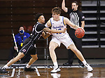 SIOUX FALLS, SD - MARCH 6: Marco Smith #22 of the Nebraska-Omaha Mavericks reaches on Luke Appel #13 of the South Dakota State Jackrabbits during the Summit League Basketball Tournament at the Sanford Pentagon in Sioux Falls, SD. (Photo by Richard Carlson/Inertia)