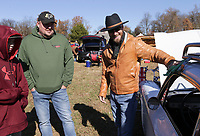 Jason Thibodaux of Bentonville (right) shows off his '63 Chevy Corvair to Joe Mikashus III (from left) and his dad Joe Mikashus Jr of Gentry,  Sunday, November 15, 2020 during a car show at the Holland Barn in Highfill. Michael Ratledge and Shane Hargrave founders of Gravette Cruise and Quarantine organized a car show fundraiser to raise money for the Arkansas children's shelter. One hundred percent of proceeds will go to the shelter said Ratledge. Check out nwaonline.com/201116Daily/ for today's photo gallery. <br /> (NWA Democrat-Gazette/Charlie Kaijo)