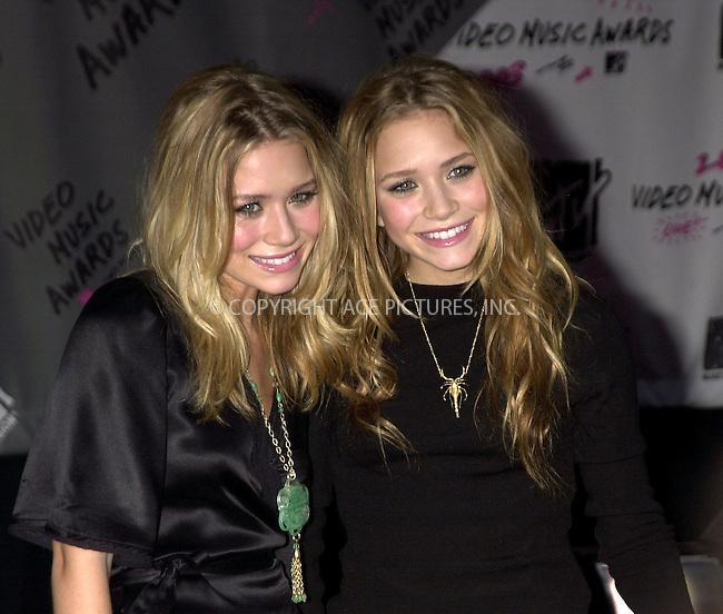 Mary Kate & Ashley Olson at 2003 Video Music Awards. New York, August 28, 2003. Please byline: NY Photo Press.   ..*PAY-PER-USE*      ....NY Photo Press:  ..phone (646) 267-6913;   ..e-mail: info@nyphotopress.com