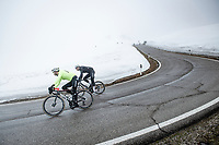 Lukasz Wisniowski (POL/Qubeka ASSOS) & Max Walscheid (DEU/Qhubeka ASSOS) coming down the misty Passo Giau<br /> <br /> due to the bad weather conditions the stage was shortened (on the raceday) to 153km and the Passo Giau became this years Cima Coppi (highest point of the Giro).<br /> <br /> 104th Giro d'Italia 2021 (2.UWT)<br /> Stage 16 from Sacile to Cortina d'Ampezzo (shortened from 212km to 153km)<br /> <br /> ©kramon