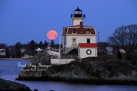 The full moon setting behind Pomham Rocks Lighthouse, Narragansett Bay RI.