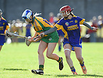 Tara Rynne of Inagh-Kilnamona in action against Aoife Griffin of Newmarket during their senior county final in Clarecastle. Photograph by John Kelly.