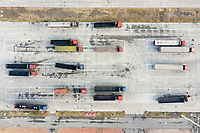 Trucks parked in a service station near the town of Ninghe, eastern Tianjin. A constant stream of trucks zigzag across the region delivering goods and materials to the ports of the region. Infrastructure is predicted to be some of the hardest hit as sea levels rise over the low-lying land in the region. 2019