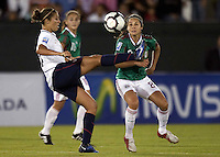 Carli Lloyd of USA (L) and Guadalupe Worbis of Mexico (R) during the semifinal match of CONCACAF Women's World Cup Qualifying tournament held at Estadio Quintana Roo in Cancun, Mexico. Mexico 2, USA 1.