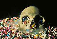 Conceptual image depicting the deadly results of drugs--human skull surrounded by pills and smoke. Birmingham Alabama United States.