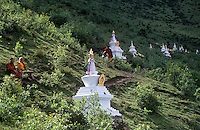Stupas & monks above the Tibetan Buddhist monastery of Katok Dorjeden - Kham, (E. Tibet), Sichuan Province, China