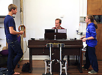 """The fawn, """"Mr Tumnus"""", and """"Lucy"""" with Musical Director, David Perkins.  The Yvonne Arnaud Youth Theatre rehearsing """"The Lion, the Witch and the Wardrobe"""", Guildford, Surrey."""