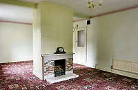 BNPS.co.uk (01202 558833)<br /> Pic: Mullucks/BNPS<br /> <br /> Lounge before.<br /> <br /> A retired couple dubbed 'the accidental upsizers' have put their luxury home on the market for a whopping £750,000.<br /> <br /> Jean and Desmond Lawton bought a suburban bungalow three years ago as they looked to downsize from a large property.<br /> <br /> But they soon decided that they didn't like the dated decour of the humble home and transformed it beyond recognition.<br /> <br /> They knocked down every internal retaining wall bar one to create an open-plan space and built a single-storey extension to the rear.