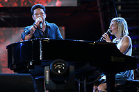 Ingrid St-Pierre and Eric Lapointe perform at the St-Jean Baptist show on the Plains of Abraham in Quebec City during the Fete nationale du Quebec, Friday June 23, 2017.