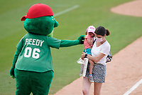 It was kids and moms run the bases after the Greenville Drive Mother's Day game on May 9, 2021. But . . . at least one child thought that being greeted by a big green fuzzy frog was a bit scary. Drive mascot Reedy Rip'It took it in stride, and the mom kept going. (Tom Priddy/Four Seam Images)