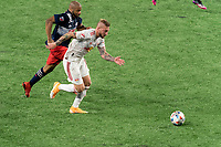 FOXBOROUGH, MA - MAY 22: Daniel Royer #77 of New York Red Bulls brings the ball forward as Andrew Farrell #2 of New England Revolution defends during a game between New York Red Bulls and New England Revolution at Gillette Stadium on May 22, 2021 in Foxborough, Massachusetts.