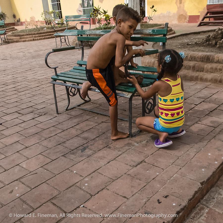Cuban kids playing in plaza