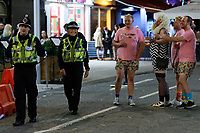 Pictured: Men in fancy dress speak with police officers in Wind Street, Swansea, Wales, UK. Saturday 07 August 2021<br /> Re: Nightclubs have reopened this weekend as most Covid restrictions have come to an end in Wales, UK.<br /> Pubs and restaurants were allowed to open for certain periods, with safety measures in place unlike nightclubs.