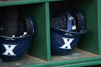 Xavier Musketeers helmets lay in the dugout during the game against the Penn State Nittany Lions at Coleman Field at the USA Baseball National Training Center on February 25, 2017 in Cary, North Carolina. The Musketeers defeated the Nittany Lions 10-4 in game one of a double header. (Brian Westerholt/Four Seam Images)