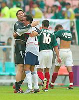 Toney Meola celebrates with Landon Donovan, right, in Jeonju, South Korea, Monday June 17, 2002. Images provided in partnership with International Sports Images. (Please credit: John Todd/Int'l Sports Images/DSA)