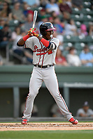 Third baseman Jean Carlos Encarnacion (14) of the Rome Braves bats in a game against the Greenville Drive on Friday, April 13, 2018, at Fluor Field at the West End in Greenville, South Carolina. Rome won, 10-6. (Tom Priddy/Four Seam Images)