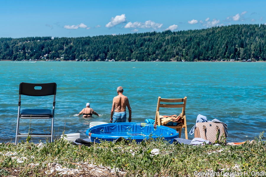 Senior citizens, Baby Boomers, take a swim in Hood Canal at Twanoh State Park, Washington, USA