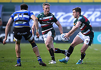 18th April 2021 2021; Recreation Ground, Bath, Somerset, England; English Premiership Rugby, Bath versus Leicester Tigers; George Ford offloads to Freddie Steward of Leicester Tigers under pressure from Will Muir of Bath