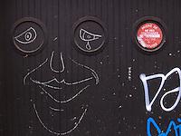 France. Paris. No parking sign on a garage door. Graffitti. 19.11.10  © 2010 Didier Ruef