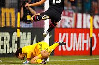 14 MAY 2011: USA Women's National Team forward Alex Morgan (13) leaps over Japan National team Ayumi Kaaihori during the International Friendly soccer match between Japan WNT vs USA WNT at Crew Stadium in Columbus, Ohio.