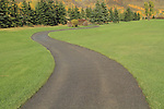 Paved pathway surrounded by a grass lawn, Vail, Colorado