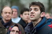 A man in the crowd argues with a Christian preacher at Speakers' Corner in Hyde Park, London.