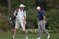 """PONTE VEDRA BEACH, FL - MAY 5: Phil Michelson and caddie Jim """"Bones"""" MacKay walk to the green of the par 3 13th hole during his practice round on Tuesday, May 5, 2009 for the Players Championship, beginning on Thursday, at TPC Sawgrass in Ponte Vedra Beach, Florida."""