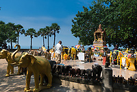 Man praying in the shrine to elephants on Promthep cape, Phuket, Thailand