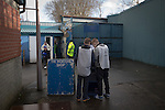 Greenock Morton 2 Stranraer 0, 21/02/2015. Cappielow Park, Greenock. Two young programme sellers waiting for fans inside the stadium before Greenock Morton take on Stranraer in a Scottish League One match at Cappielow Park, Greenock. The match was between the top two teams in Scotland's third tier, with Morton winning by two goals to nil. The attendance was 1,921, above average for Morton's games during the 2014-15 season so far. Photo by Colin McPherson.