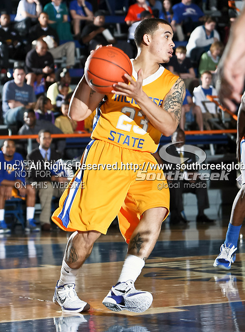 McNeese State Cowboys guard C.J. Collins (23) in action during the game between the McNeese State Cowboys and the UTA Mavericks held at the University of Texas at Arlington's, Texas Hall, in Arlington, Texas.  McNeese State defeats UTA 81 to 72.