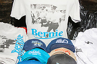 Vendors sell campaign buttons, shirts, and hats, outside a campaign rally for Democratic presidential candidate and Vermont senator Bernie Sanders Hampshire at Hills Athletic Club in Milford, New Hampshire, on Tue., Feb. 4, 2020. The  event started around 7pm and was the first event Sanders held after the previous day's Iowa Caucuses. The results of the caucuses were unknown until the Democratic party released partial numbers at 5pm, showing Sanders and former South Bend, Ind., mayor Pete Buttigieg both as frontrunners.