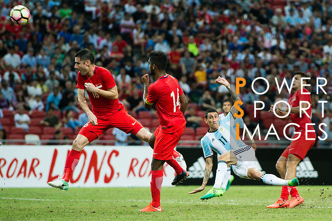 Angel Di Maria of Argentina (C) attempts a kick during the International Test match between Argentina and Singapore at National Stadium on June 13, 2017 in Singapore. Photo by Marcio Rodrigo Machado / Power Sport Images