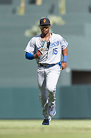 Surprise Saguaros right fielder Khalil Lee (15), of the Kansas City Royals organization, jogs off the field between innings of an Arizona Fall League game against the Salt River Rafters at Salt River Fields at Talking Stick on October 23, 2018 in Scottsdale, Arizona. Salt River defeated Surprise 7-5 . (Zachary Lucy/Four Seam Images)