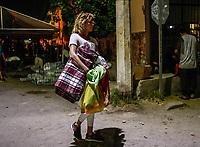 """Travesti. Transexual. Migrantes reciben atención medica, alimentación, aseo personal y un lugar para descansar en el comedor Comunitario de la Colonia San Luis de Hermosillo Sonora.<br /> <br /> La Caravana del Migrante con un contingente de alrededor de 600 personas en su mayoría de origen centroamericano, arribo a Hermosillo Sonora a bordo del tren conocido como """"La Bestia"""", provienen de la frontera Sur del País y con rumbo a la ciudad de Mexicali donde continuaran el viaje hasta Tijuana.<br /> La caravana tiene como objetivo solicitar <br /> asilo a Estados Unidos y algunos integrantes piensan solicitar una visa humanitaria en México para laborar en los campos de Sonora y Baja California.<br /> Photo: NortePhoto/Luis Gutiérrez)"""