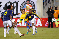 Neymar (11) of Brazil beats  Aquivaldo Mosquera (22) of Colombia to score. Brazil (BRA) and Colombia (COL) played to a 1-1 tie during international friendly at MetLife Stadium in East Rutherford, NJ, on November 14, 2012.