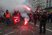 French rail workers march through Paris while on strike against neoliberal reforms being proposed by President Macron. Rail workers would lose their protection against mass dismissal and the way would be cleared for privatisation. Paris, France 22-3-18