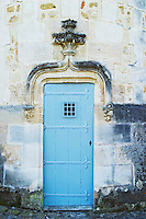 A trompe l'oeil door painted to look like wrought iron on one of the towers.  - Chateau Carignan, Premieres Cotes de Bordeaux