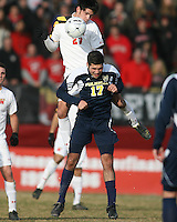 John Stertzer #27 of the University of Maryland gets above Hamoody Saad #17 of the University of Michigan during an NCAA quarter-final match at Ludwig Field, University of Maryland, College Park, Maryland on December 4 2010.Michigan won 3-2 AET.